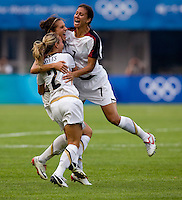 USWNT midfielder (11) Carli Lloyd celebrates a goal with teammates (7) Shannon Boxx and (2) Heather MItts while playing at Qinhuangdao Stadium. The US defeated Japan, 1-0, during first round play at the 2008 Beijing Olympics in Qinhuangdao, China.