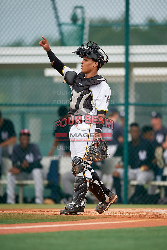 GCL Pirates catcher Samuel Inoa (54) signals to the defense during the first game of a doubleheader against the GCL Yankees East on July 31, 2018 at Pirate City Complex in Bradenton, Florida.  GCL Yankees East defeated GCL Pirates 2-0.  (Mike Janes/Four Seam Images)