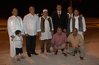 """Tripoli, Libya.  Muslim Wedding Celebrations.  Groom and Family Members.  The groom has just been escorted to begin the """"taddrija"""", a slow musical march to the place where the groom will meet his wife for their first night together.  Three men wear the """"farmla"""", the traditional Libyan vest."""