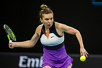 8th February 2021; Melbourne, Victoria, Australia;  Simona Halep of Romania returns the ball during round 1 of the 2021 Australian Open on February 8 2020, at Melbourne Park in Melbourne, Australia.