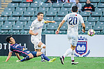 SC Kitchee Midfielder Ka Wai Lam (l) trips up with Auckland City Midfielder Mario Bilen (c) during the Nike Lunar New Year Cup 2017 match between SC Kitchee (HKG) and Auckland City FC (NZL) on January 31, 2017 in Hong Kong, Hong Kong. Photo by Marcio Rodrigo Machado / Power Sport Images