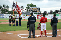 July 3, 2009:  United States Marine Corps (USMC) present the flag before a game at Dwyer Stadium in Batavia, NY.  The Muckdogs are the NY-Penn League Short-Season Class-A affiliate of the St. Louis Cardinals.  Photo By Mike Janes/Four Seam Images