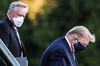 U.S. President Donald Trump exits Marine One as White House Chief of Staff Mark Meadows, left, looks, while arriving to Walter Reed National Military Medical Center in Bethesda, Maryland, U.S., on Friday, Oct. 2, 2020. Trump will be treated for Covid-19 after being in isolation at the White House since his diagnosis, which he announced after one of his closest aides had tested positive for coronavirus infection.<br /> Credit: Oliver Contreras/ Pool via CNP/AdMedia