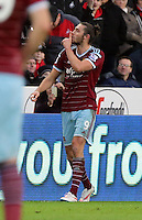 Pictured: Andy Carroll of West Ham celebrating his opening goal Saturday 10 January 2015<br /> Re: Barclays Premier League, Swansea City FC v West Ham United at the Liberty Stadium, south Wales, UK
