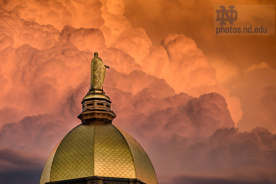 June 20, 2016; Storm clouds lit by the setting sun behind the Dome. (Photo by Matt Cashore/University of Notre Dame)
