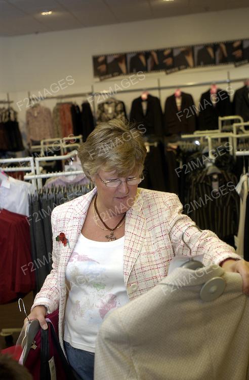 .Shopping in a clothes shop.Photo Alan Edwards