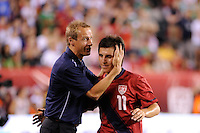 United States head coach Jurgen Klinsmann greets  Jose Torres (11) as he is subbed out. The men's national teams of the United States (USA) and Mexico (MEX) played to a 1-1 tie during an international friendly at Lincoln Financial Field in Philadelphia, PA, on August 10, 2011.
