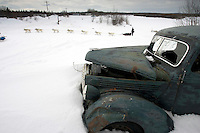 Jim Lanier Drives Team Past Abandoned Truck Anvik Chkpt 2005 Iditarod