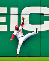 13 April 2009: Washington Nationals' outfielder Lastings Milledge makes a catch against the left field wall to end the inning against the Philadelphia Phillies during the Nats' Home Opener at Nationals Park in Washington, DC. The Nats fell short in their 9th inning rally, losing 9-8, and marking their 7th consecutive loss of the 2009 season. Mandatory Credit: Ed Wolfstein Photo