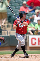 Nashville Sounds outfielder Caleb Gindl #13 swings against the Round Rock Express in Pacific Coast League baseball on May 9, 2011 at the Dell Diamond in Round Rock, Texas. (Photo by Andrew Woolley / Four Seam Images)