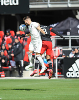 WASHINTON, DC - FEBRUARY 29: Washington, D.C. - February 29, 2020: Keegan Rosenberry #2 of the Colorado Rapids heads the ball against Ulises Segura #8 of D.C. United. The Colorado Rapids defeated D.C. United 2-1 during their Major League Soccer (MLS)  match at Audi Field during a game between Colorado Rapids and D.C. United at Audi FIeld on February 29, 2020 in Washinton, DC.