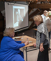 """Denise Robertson, writer and broadcaster, talking with Jenny Ellis, Leila Berg's daughter, at an evening celebrating the work of Leila Berg and the official opening of her archive at Seven Stories in Newcastle, 19th September 2012.  Denise was one of the writers whom Leila engaged to write a """"Nippers"""" story (""""The New Bath"""") for kids when Leila was editor at Methuen publishers."""