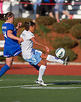 Chicago Red Stars forward Maribel Domingues (9) intercepts the ball at the sideline with Boston Breakers defender Cat Whitehill (4) in pursuit.  In a National Women's Soccer League Elite (NWSL) match, the Boston Breakers defeated  Chicago Red Stars 4-1, at the Dilboy Stadium on May 4, 2013.