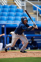 Lakeland Flying Tigers left fielder Derek Hill (18) follows through on a swing during a game against the Dunedin Blue Jays on May 27, 2018 at Dunedin Stadium in Dunedin, Florida.  Lakeland defeated Dunedin 2-1.  (Mike Janes/Four Seam Images)