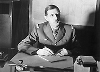 Commander of Free French Forces General Charles de Gaulle seated at his desk in London during the Second World War. Commander of Free French Forces General Charles de Gaulle seated at his desk in London during the Second World War.
