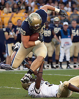Pittsburgh tight end Nate Byham jumps over a Navy defender. The Pittsburgh Panthers defeated the Navy Midshipmen 27-14 at Heinz Field, Pittsburgh, PA.
