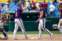 Clemson celebrates after beating Arizona State in Game 4 of the NCAA Division One Men's College World Series on Monday June 21st, 2010 at Johnny Rosenblatt Stadium in Omaha, Nebraska.  (Photo by Andrew Woolley / Four Seam Images)
