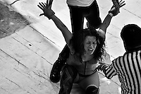 """A female Lucha libre wrestler Sahori seen locked in a painful hold during a fight at a local arena in Mexico City, Mexico, 30 April 2011. Lucha libre, literally """"free fight"""" in Spanish, is a unique Mexican sporting event and cultural phenomenon. Based on aerial acrobatics, rapid holds and the use of mysterious masks, Lucha libre features the wrestlers as fictional characters (Good vs. Evil). Women wrestlers, known as luchadoras, often wear bright shiny leotards, black pantyhose or other provocative costumes. Given the popularity of Lucha libre in Mexico, many wrestlers have reached the cult status, showing up in movies or TV shows. However, almost all female fighters are amateur part-time wrestlers or housewives. Passing through the dirty remote areas in the peripheries, listening to the obscene screams from the mainly male audience, these no-name luchadoras fight straight on the street and charge about 10 US dollars for a show. Still, most of the young luchadoras train hard and wrestle virtually anywhere dreaming to escape from the poverty and to become a star worshipped by the modern Mexican society."""