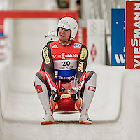 4 December 2015: Peter Penz and Georg Fischler, sliding for Austria, cross the finish line after their second run, finishing 2nd for the day with a combined time of 1:27.965 in the Doubles Competition of the Viessmann Luge World Cup at the Olympic Sports Track in Lake Placid, New York, USA. Mandatory Credit: Ed Wolfstein Photo *** RAW (NEF) Image File Available ***