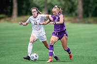 SANFORD, FL - APRIL 3: Heather Payne #12 of FSU and Courtney Petersen of the Orlando Pride battle for the ball during a game between Florida State Seminoles and Orlando Pride at Sylvan Park Training Center on April 3, 2021 in Sanford, Florida.