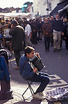 Child poverty Immigrant teenager from Eastern European busking Portobello Road London UK 1990s 90s