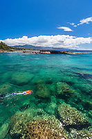 Snorkelers in clear water at Shark's Cove, North Shore of O'ahu.