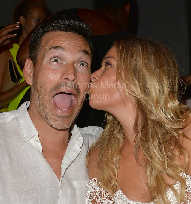 MIAMI, FL - JULY 20: Eddie Cibrian and LeAnn Rimes attend Luli Fama fashion show during Mercedes-Benz Fashion Week Swim 2015 at Cabana Grande at The Raleigh on July 20, 2014 in Miami, Florida.<br /> <br /> People:  LeAnn Rimes, Eddie Cibrian<br /> <br /> Transmission Ref:  FLXX<br /> <br /> Must call if interested<br /> Michael Storms<br /> Storms Media Group Inc.<br /> 305-632-3400 - Cell<br /> 305-513-5783 - Fax<br /> MikeStorm@aol.com<br /> www.StormsMediaGroup.com