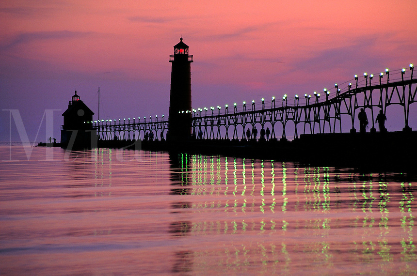 popular summer resort town on Lake Michigan features lighthouse at Grand Haven State Park, lighthouses. Grand Haven Michigan USA.