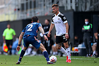 12th September 2020; Craven Cottage, London, England; English Premier League Football, Fulham versus Arsenal; Joe Bryan of Fulham is under pressure from Hector Bellerín of Arsenal