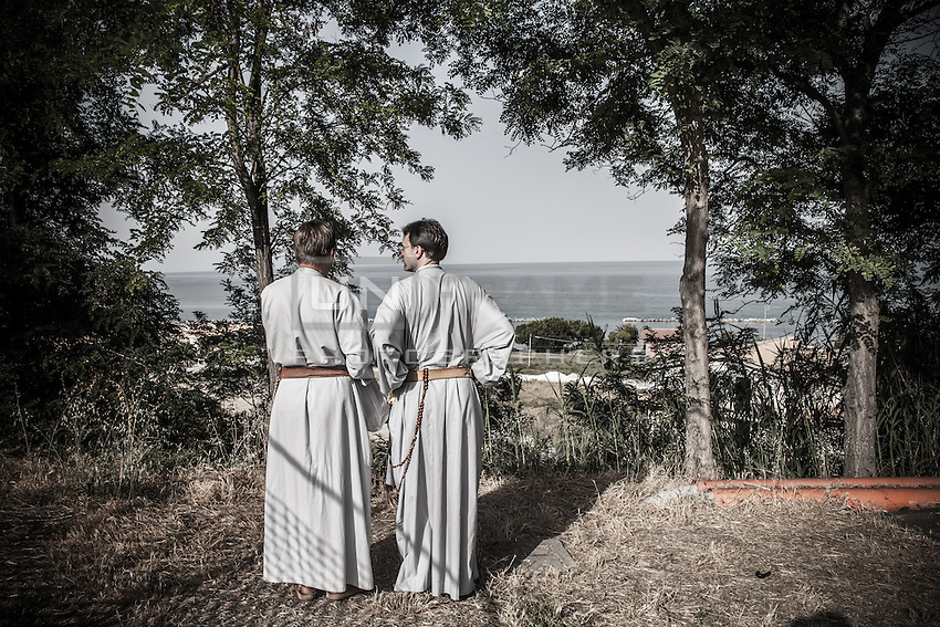 Pilgrim friars along their way to Medjugorje.<br /> Near San Benedetto del Tronto, Italy