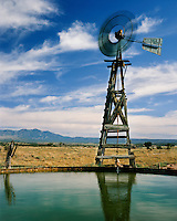 Windmill reflected in a water tank on a ranch near Las Cruces, NM