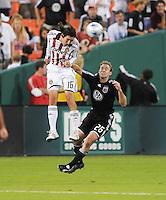Chivas USA midfielder Sacha Kljestan (16) goes up to head the ball against DC United defender Bryan Namoff (26). Chivas USA defeated DC United 3-0, Saturday October 4, 2008 at RFK Stadium.