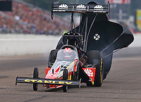 Aug 17, 2014; Brainerd, MN, USA; NHRA top fuel dragster driver Doug Kalitta loses body panels during the Lucas Oil Nationals at Brainerd International Raceway. Mandatory Credit: Mark J. Rebilas-