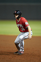 Zach Clark (10) of the Carolina Mudcats takes his lead off of first base against the Winston-Salem Dash at BB&T Ballpark on June 1, 2019 in Winston-Salem, North Carolina. The Dash defeated the Mudcats 5-4 in game two of a double header. (Brian Westerholt/Four Seam Images)