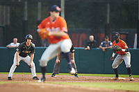 Matt Hudgins (5) of the Army Black Knights takes his lead off of first base while being held on by Josh Anthony (3) of the Auburn Tigers as Casey Mize (32) begins his wind-up at Doak Field at Dail Park on June 2, 2018 in Raleigh, North Carolina. The Tigers defeated the Black Knights 12-1. (Brian Westerholt/Four Seam Images)