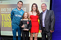 Pictured: Lukasz Fabianski (L) and Katy Hosford (3rd L). Thursday 15 March 2018<br /> Re: Swansea City AFC Community Trust Celebration Event at the Liberty Stadium, Swansea, Wales, UK.
