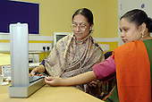 A doctor checks blood pressure of a member of the Bengali Women's Health Project in Camden, London.
