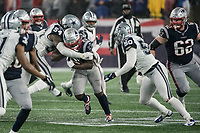 FOXBOROUGH, MA - NOVEMBER 24: Dallas Cowboys Linebacker Jaylon Smith #54 wraps up New England Patriots Runningback Sony Michel #26 with Dallas Cowboys Linebacker Sean Lee #50 in support during a game between Dallas Cowboys and New England Patriots at Gillettes on November 24, 2019 in Foxborough, Massachusetts.