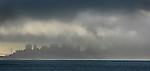 The weather over the city of San Francisco California is has hug rain clouds that blanket the city as seen from the Sausalito.