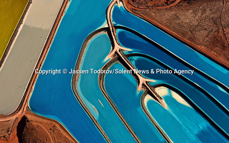 Pictured: The electric blue 'pools' of potash near Moab, Utah, USA.<br /> <br /> Amazing aerial photos show off the majesty of America's landscape, its architecture, its industry and its wildlife.   From the startling blue potash pools of Utah to hundreds of aircraft sitting unused due to the pandemic, the images display a little seen side of the USA.<br /> <br /> Other images include a passenger plane plane as it touches down in California taken 4,500ft above it, fog over the Golden Gate Bridge and a solar farm in Nevada.   Professor of Music Jassen Todorov, from San Francisco, captured the striking pictures of the American West while flying in a light aircraft.   SEE OUR COPY FOR DETAILS<br /> <br /> Please byline: Jassen Todorov/Solent News<br /> <br /> © Jassen Todorov/Solent News & Photo Agency<br /> UK +44 (0) 2380 458800