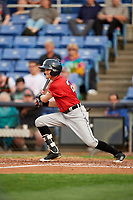 Erie SeaWolves left fielder Danny Woodrow (22) follows through on a swing during a game against the Binghamton Rumble Ponies on May 14, 2018 at NYSEG Stadium in Binghamton, New York.  Binghamton defeated Erie 6-5.  (Mike Janes/Four Seam Images)
