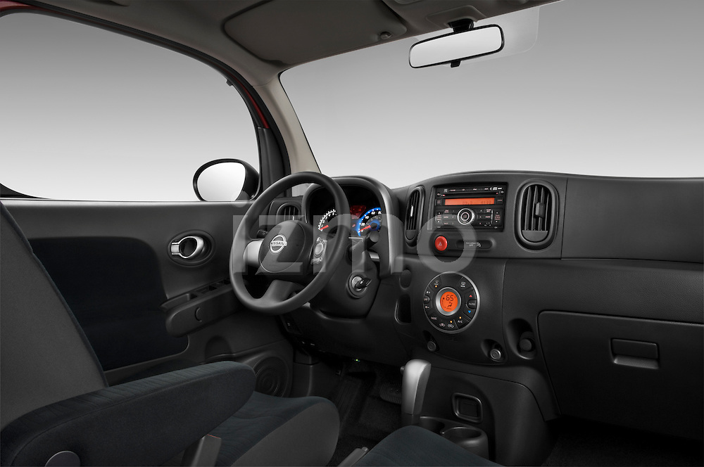 Low angle passenger side dashboard view of a 2009 Nissan Cube SL.