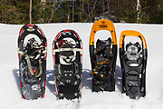 Snowshoes on display in snowbank in the White Mountains of New Hampshire USA during the spring months
