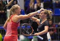 Rotterdam, Netherlands, December 20, 2015,  Topsport Centrum, Lotto NK Tennis, Final womans single Kiki Bertens (L) congratulates Richel Hogenkamp with her win and embrace.<br /> Photo: Tennisimages/Henk Koster