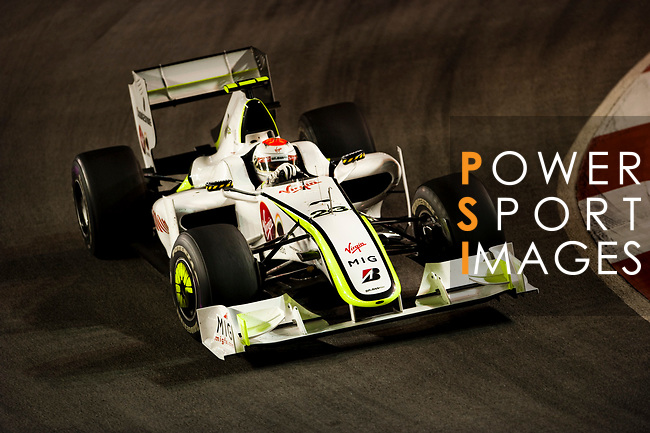 27 Sept 2009, Singapore --- Brawn GP Formula 1 Team driver Rubens Barrichelo of Brazil steers his car during the Fia Formula One 2009 Singtel Singapore Grand Prix, the world's only street night race, at the Marina Bay street circuit. Photo by Victor Fraile --- Image by © Victor Fraile/Corbis