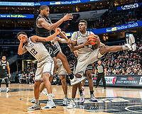 WASHINGTON, DC - FEBRUARY 19: Qudus Wahab #34 of Georgetown pulls in a rebound from Alpha Diallo #11 of Providence during a game between Providence and Georgetown at Capital One Arena on February 19, 2020 in Washington, DC.
