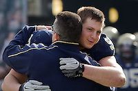 Pitt head coach Todd Graham gives Chas Alecxih a hug on Senior Day. The Pittsburgh Panthers beat the Syracuse Orange 33-20 at Heinz Field in Pittsburgh, Pennsylvania on December 3, 2011
