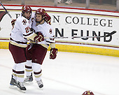 Matt Price (BC - 25), Paul Carey (BC - 22) - The Boston College Eagles defeated the Merrimack College Warriors 4-3 on Friday, October 30, 2009, at Conte Forum in Chestnut Hill, Massachusetts.