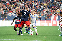 FOXOBOROUGH, MA - AUGUST 21: Andrew Farrell #2 of New England Revolution defends as Alvaro Barreal #31 of FC Cincinnati brings the ball forward during a game between FC Cincinnati and New England Revolution at Gillette Stadium on August 21, 2021 in Foxoborough, Massachusetts.