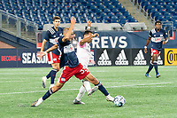 FOXBOROUGH, MA - SEPTEMBER 04: Tiago Mendonca #33 of New England Revolution II stretches to take the ball from Paulo Junior #11 Forward Madison FC during a game between Forward Madison FC and New England Revolution II at Gillette Stadium on September 04, 2020 in Foxborough, Massachusetts.